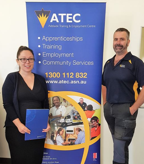 ATEC staff with their winner's certificate