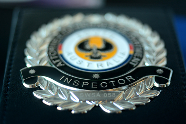 Close up of SafeWork SA Inspector identification badge