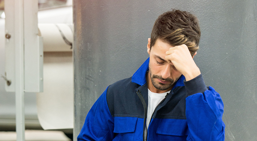 Worker looking depressed and stressed