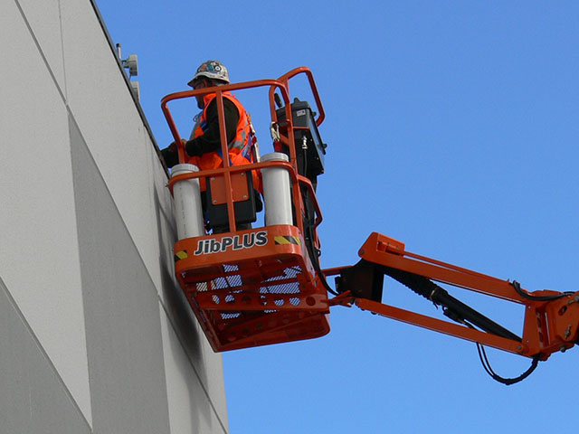 Worker on a elevating work platform with no overhead dangers